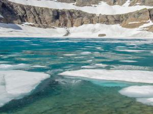 Iceberg Lake retains icebergs into August.