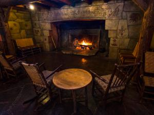 Cozy up to the fireplace at Lake McDonald Lodge.
