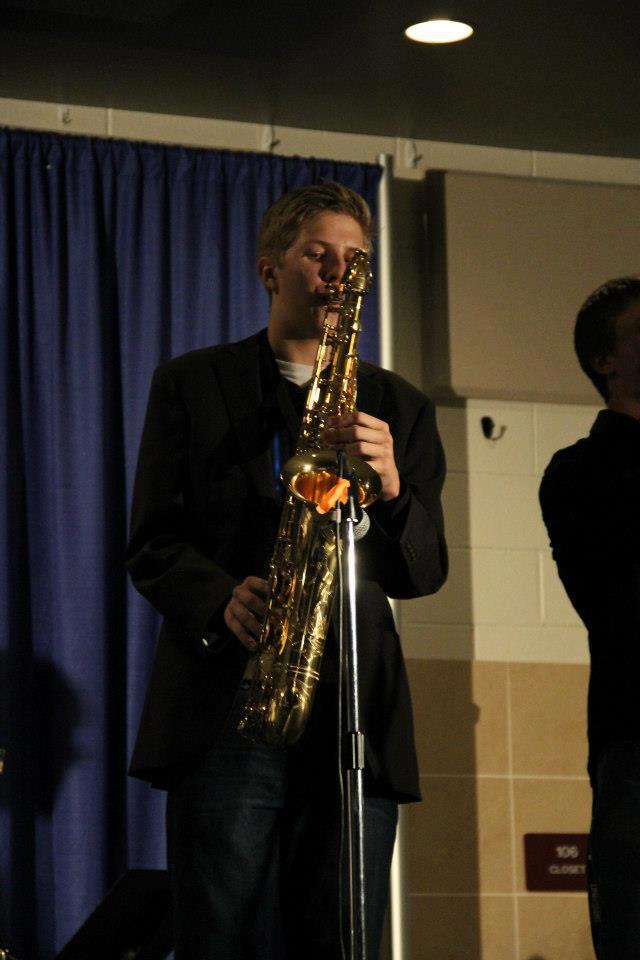 Alex Thomson plays his saxophone at a benefit concert in December