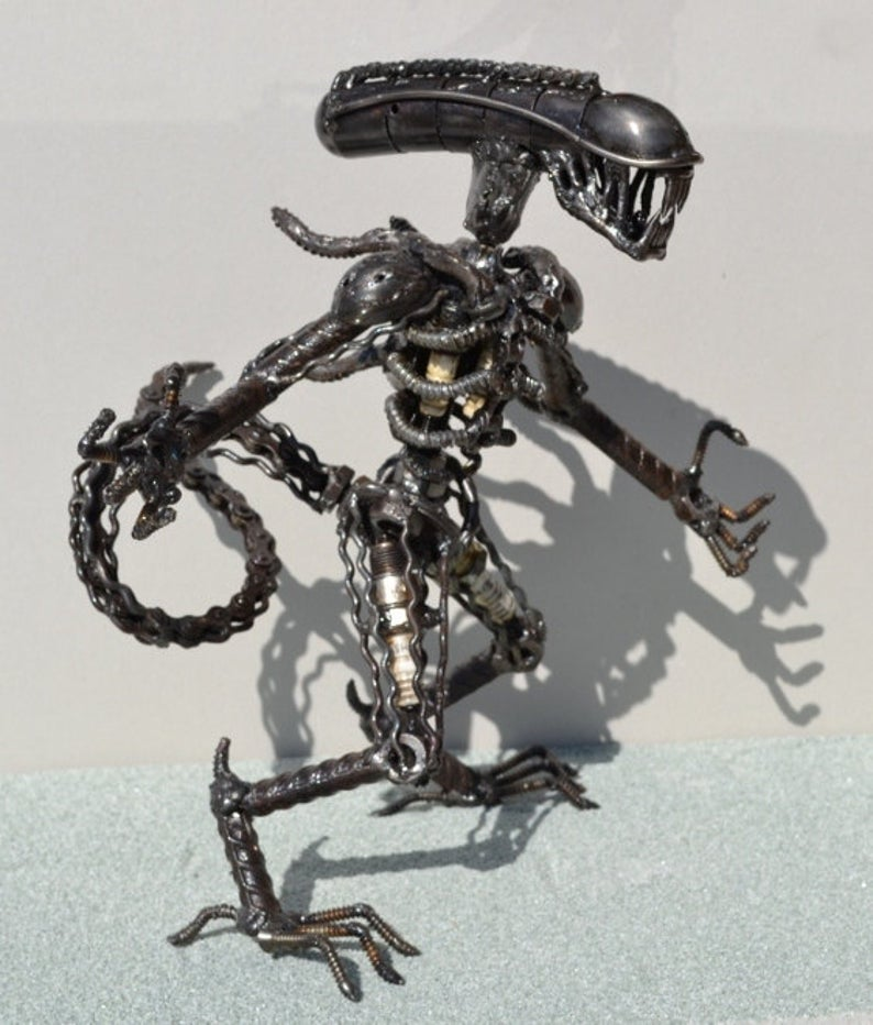 Hand Made Alien Recycled/Upcycled Scrap Metal Art Sculpture. Photographs credited to ScrapSculptures.
