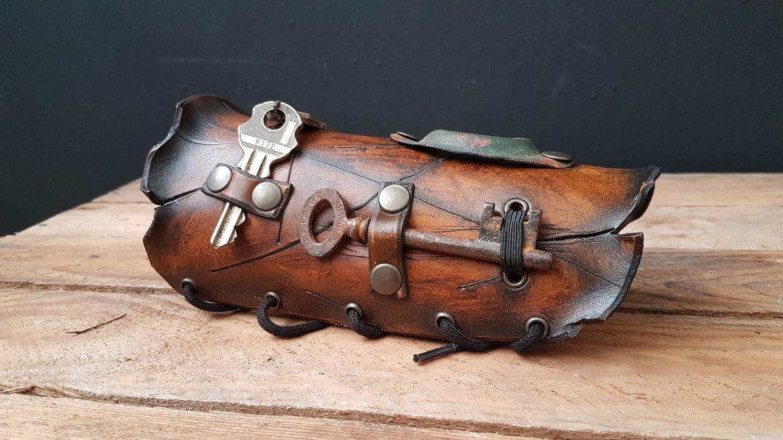 Carved Leather Steampunk Arm Bracer with keys. Photos credited to PenelopesCounter.