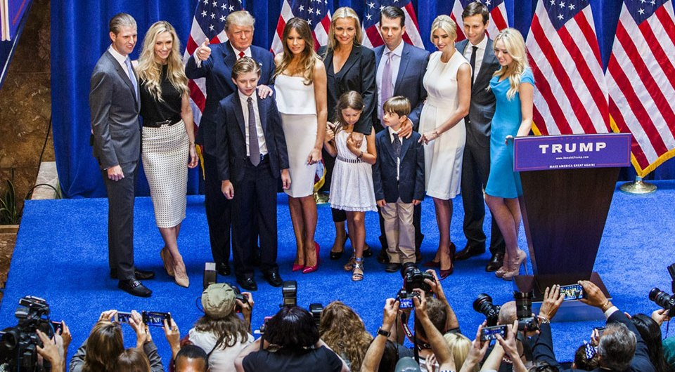 Donald Trump and his family posing for a picture.