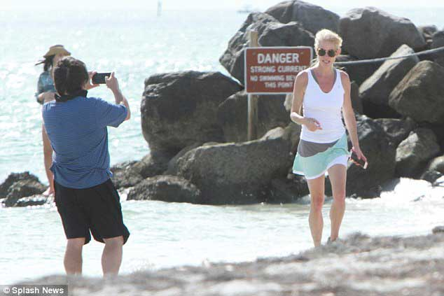 Kellyanne Conway with her husband George T Conway in beach side Florida. George is taking her pictures.