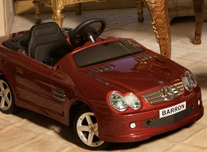 Barron Trump's red convertible toy; the licence plate has his name on it.