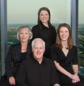 John Corny with his wife and two daughters.