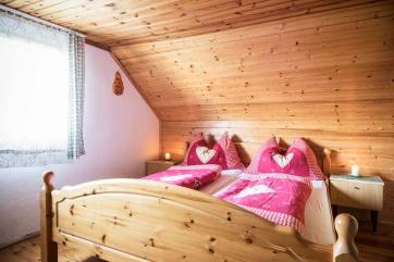 """Almhütte """"Brandnerhütte"""" – Schlafzimmer / Doppelbett"""