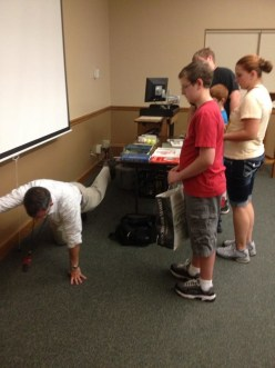 Physical Therapist demonstrates for kids after giving lunch lecture