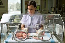BABY INSIDE INFANT INCUBATOR