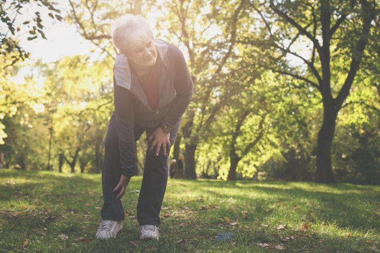 Senior woman experiencing leg pain