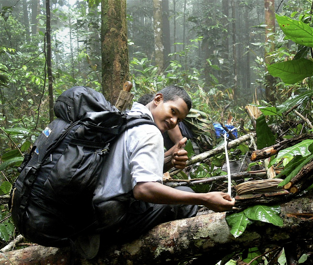 Joseph, Makushi technician measuring distance to a sighted animal.  He is in cloud forest on top of the Kanuku mountains.