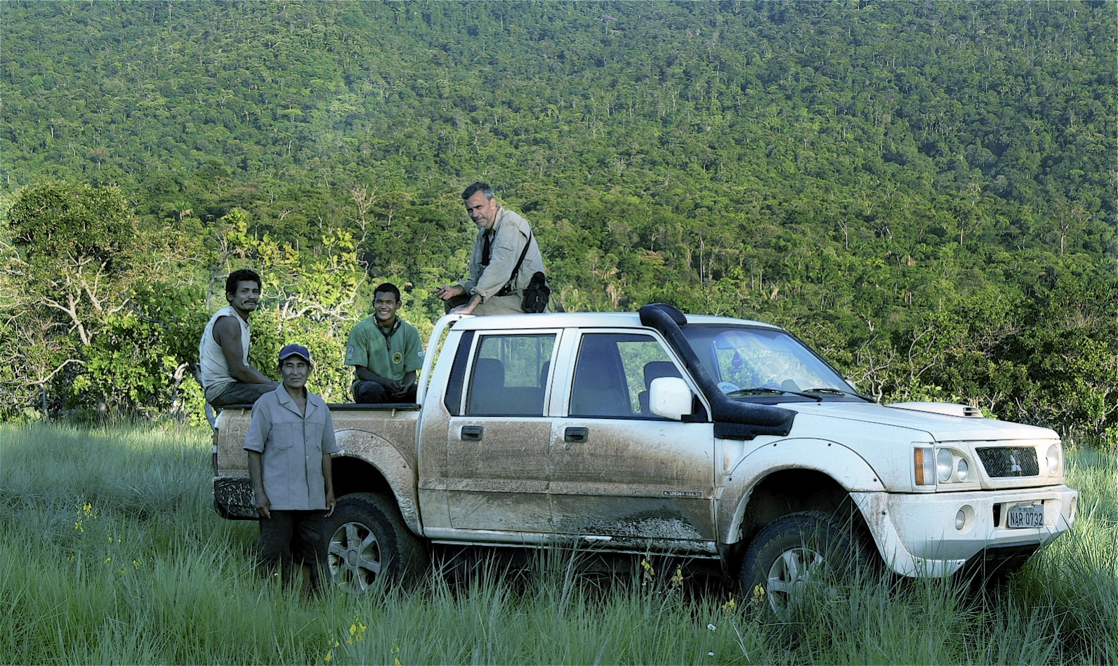 One of our transect search teams parked at the base of the Kanuku mountains. Sitting on the roof of the pickup is co-author L. Flamarion de Oliveira, a researcher with Brazil's Museu Nacional.  In the back of the pickup are Joseph and Samson, two of our Makushi technicians who actually walk the transects alone.