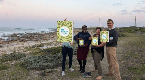 The team proudly doing some marketing for the book launch of Sea to Source. Photo courtesy of Kerry Brink