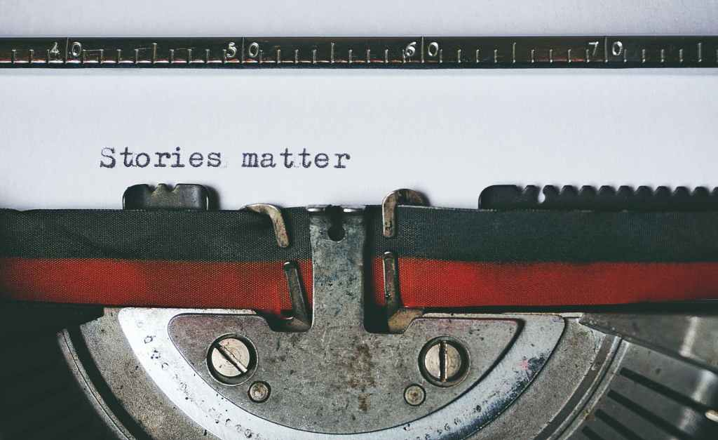 Picture of typewriter typing Stories Matter