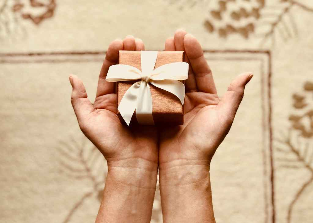 Picture of woman holding gift box in her cupped hands