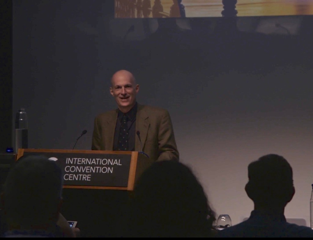 This is a picture of John Budin MD presenting at the Inteernational Convention Centre Sydney Australia 2020