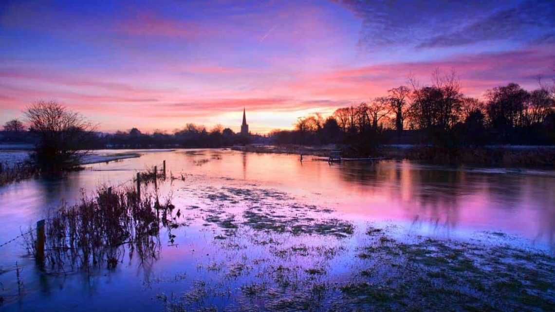 Looking Towards Burford with the River Windrush in Flood-min