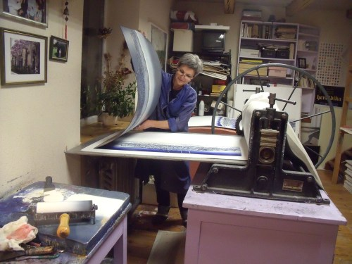 Daliute making a print in her studio