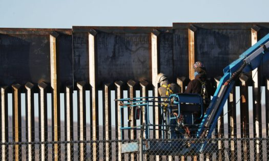 People work on the U.S.-Mexico border wall in El Paso, Texas, on Feb. 12, 2019. (Joe Raedle/Getty Images)