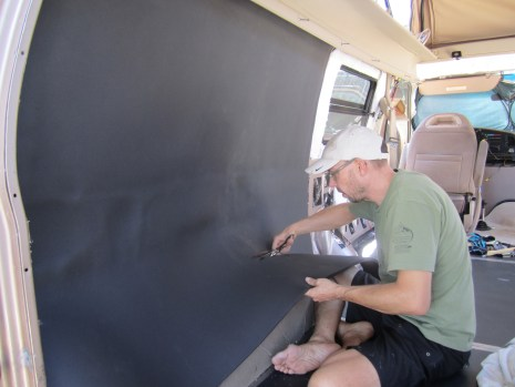 Josh installing the closed cell foam over the other insulation.