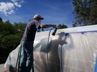 Painting the pop-top with Raptor liner