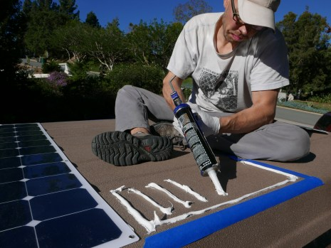 Gluing down the solar panels with sika