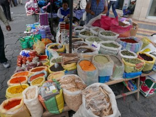 Spices and beans for sale at the Otavalo Market