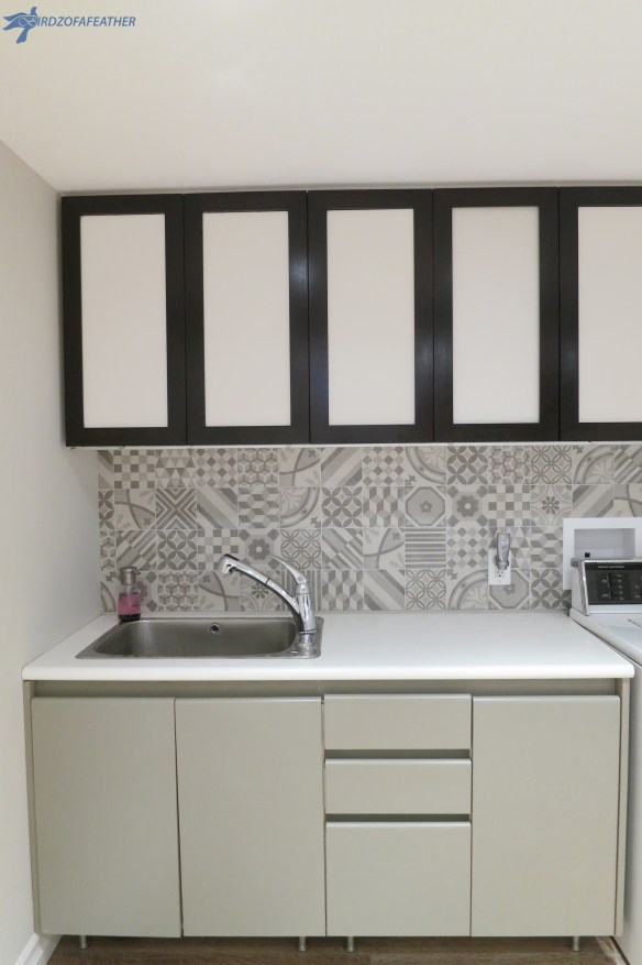 When we were looking for backsplash ideas for our laundry room, we chose a patterned backsplash tile. This tutorial shows how to tile a patterned backsplash | Birdz of a Feather | laundry room backsplash | laundry room backsplash ideas | laundry room tile | diy backsplash | patterned tile backsplash | porcelain tile ideas | laundry room backsplash | laundry room backsplash ideas | laundry room backsplash tile | laundry room backsplash tile ideas | laundry room tile ideas | laundry room tile | laundryroom walltileideas | laundryroomtile backsplash | tiledlaundryroom walls | how to install backsplash tile | how to install backsplash around outlets
