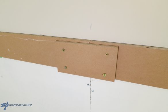 A ledger board is a must-have step for supporting the weight of the tile as it dries when starting with a clean slate (no lower cabinets). In this article, we explain how to install a ledger board to keep wall tile level when installing. | Birdz of a Feather | Ledger Board | How to Install a Ledger Board | Ledger Board Attachment | Tile a Backsplash | Tile a Backsplash DIY | tile backsplash in laundry room | laundry room backsplash | laundry room backsplash DIY