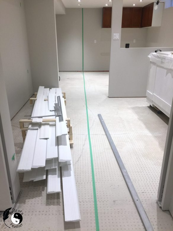 Green tape along the laser line can preserve it as you lay the flooring