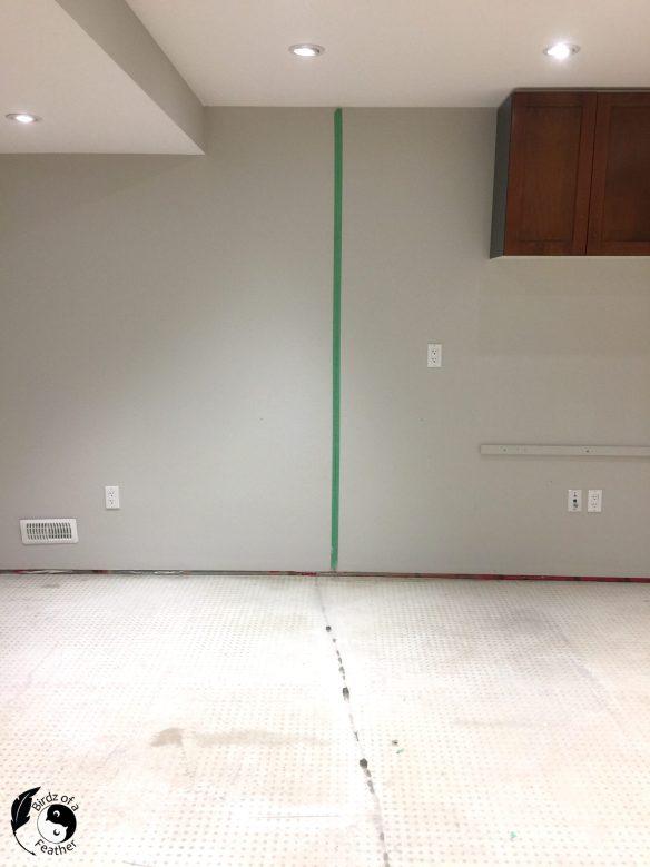 Establish a centre line with a laser level on the concrete basement floor before installing vinyl flooring