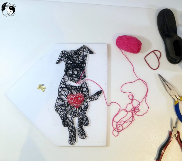 Just like a real dog, this DIY string art dog tugs at the heart strings! Birdz of a Feather   string art dog patterns   string art dog template   string art dog leash holder   string art patterns   string art patterns free   string art designs   string art ideas   string art diy   string art templates   dog crafts   world dog day   dog diy   dog diy projects   dog diy stuff   dog diy projects crafts   dog diy crafts   dog art   upcycling   upcycled crafts   upcycling ideas   upcycle projects