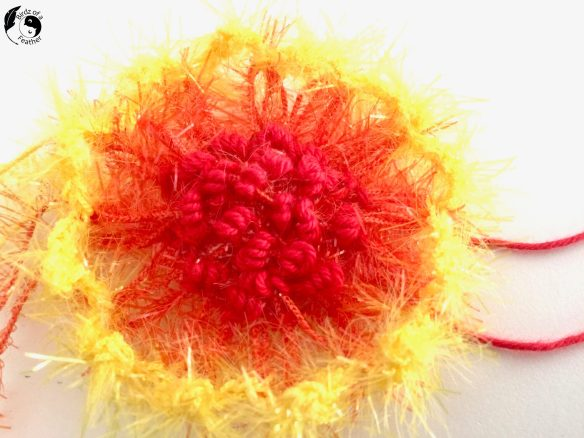 Closeup of embroidery on crazy daisy creation for Crochet coral reef