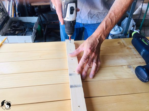 Screw a batten into the back of the pallet clock for Wooden Wall Art DIY