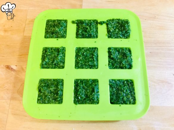 Silicone tray filled with chimichurri sauce ready to freeze and store