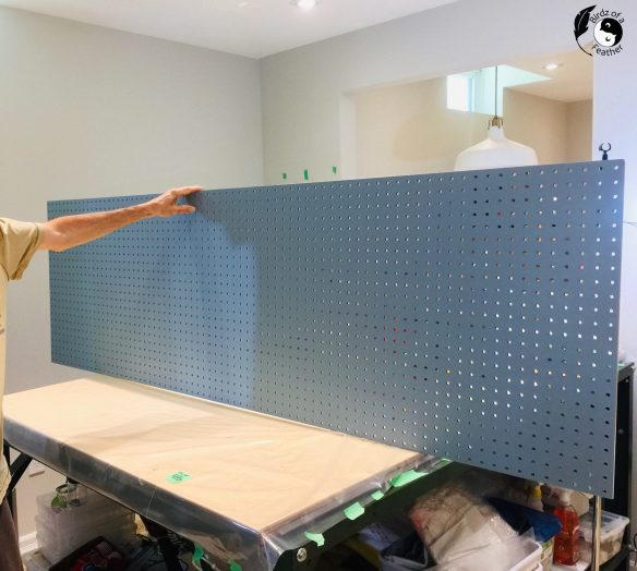 painted blue pegboard craft organizer