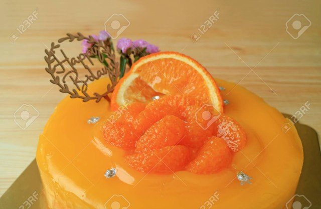 Orange Birthday Cake Vibrant Color Mandarin Orange Birthday Cake On The Wooden Table