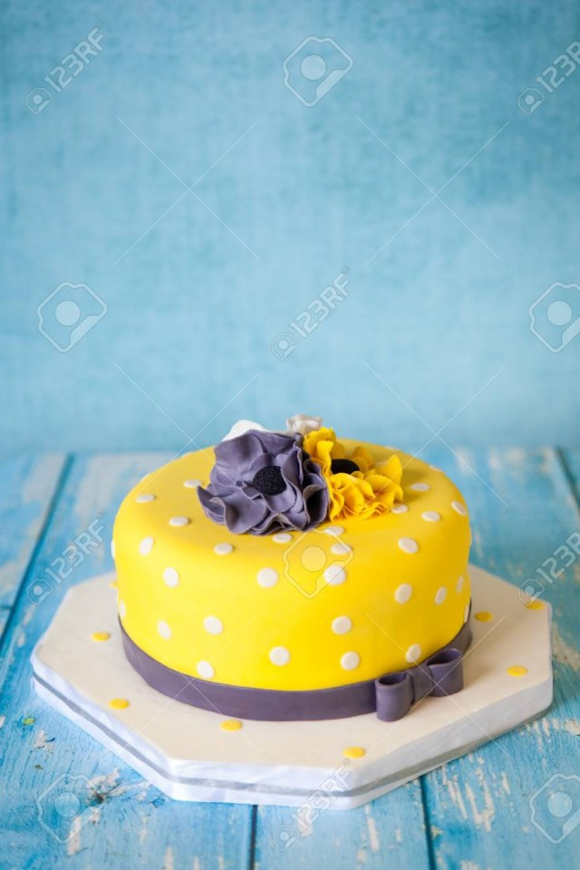 Yellow Birthday Cake Yellow Birthday Cake With White Grey And Yellow Anemones Flowers