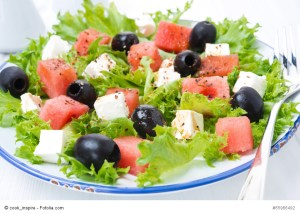 fresh salad with watermelon, feta cheese and olives, close-up