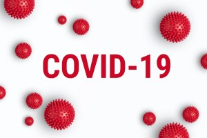 """COVID-19"" on white background with spiky cells"