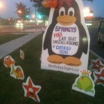 Penguin sign with frogs and fish