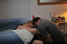 A couple hugging during labour.