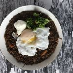 These Indian Spiced Crockpot Lentils are based on black dal, rich in flavor & health benefits, & versatile: Serve over rice or top with a runny egg! www.biscuitsandbooze.com