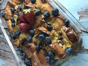 This berry brioche baked french toast is a crowd pleaser that can be made the day before. Alternate the berries for a dish that's both pretty and tasty! www.biscuitsandbooze.com