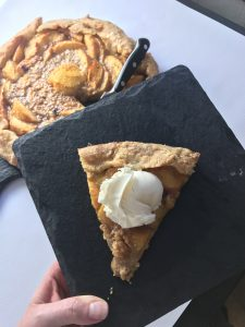 Rustic Whiskey Peach Galette is a bright and nuanced pie, with complex notes from the whiskey combined with the natural roasted sweetness of the stone fruit. It's an elegant and easy addition to your summer dining table! Vegetarian | Dessert | Summer Dessert www.biscuitsandbooze.com