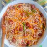 Sausages and spaghetti with vegetables