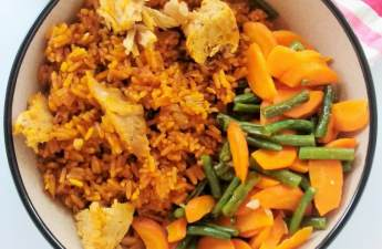 Classic West African rice dish cooked by steaming rice in tomato gravy and finished with the addition of tuna. Carrots and green beans make an excellent side.