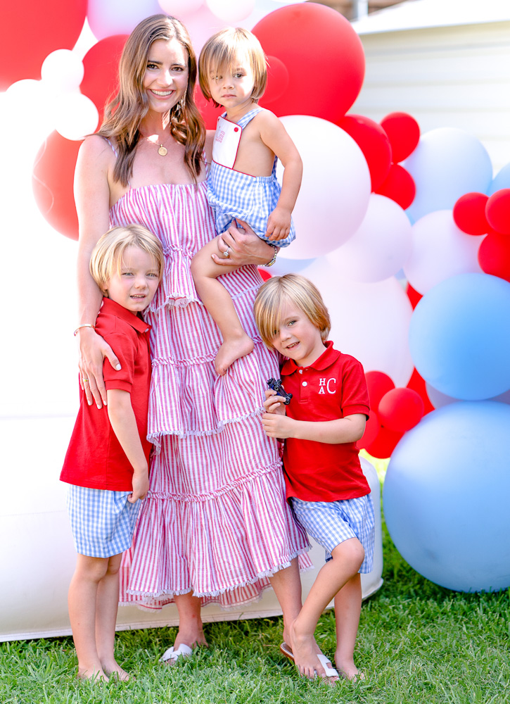 mom with three little boys in red white and blue