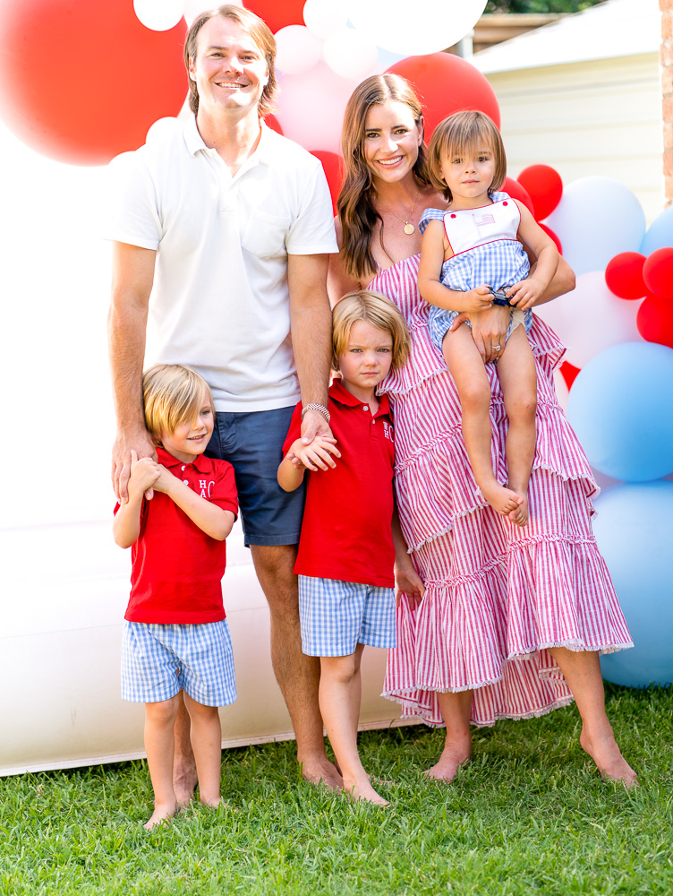 family with three boys in red white and blue
