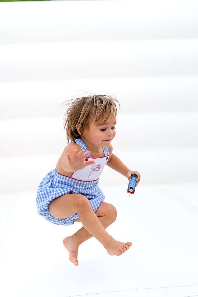 toddler boy jumping midair