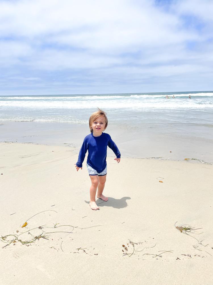toddler boy at the beach